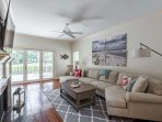 Brand new living room furniture enhances your enjoyment of the 65' curved HGTV and the view of the golf course.