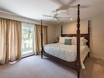 2nd en suite master bedroom upstairs features a king size bed, bathroom and sliding glass doors to a balcony...