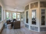 Screened in luxury seating directly off the kitchen  helps you extend your memorable days on Seabrook Island while...