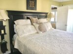 New bedding completes the beautiful master bedroom with king size bed.
