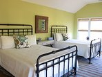 The 2nd bedroom on this level has two queen beds, & high ceilings.