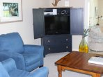 The armoire holds a new SMART HDTV and DVD player.