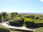Step off the deck to the boardwalk that leads to Pelican Beach.