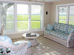 Enjoy reading in the sun room or watching the sun set over the marsh.