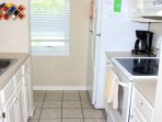This kitchen is well stocked and features updated appliances.