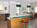 The kitchen and dining area open into the living space.
