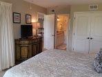 Master bedroom, view from windows towards bath room & large closet. 9 ft sliding door to patio.