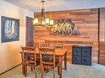 Gather around the 4-person dining table for delicious home-cooked meals and family games.