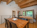 Enjoy a meal with your group on the rustic dining room table.