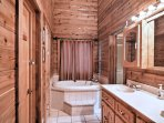 The master en-suite bathroom comes complete with double sinks, a jacuzzi tub and walk-in shower.