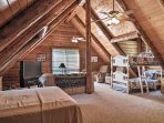 This bonus room includes twin-over-twin bunk beds, a queen sleeper sofa and a satellite TV.