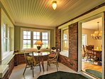 The sun room is the perfect spot for playing a board game or sipping a refreshing beverage.