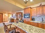 Granite counter-tops provide ample space for preparing meals.