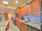 The modern kitchen is fully equipped for any home-cooking needs.