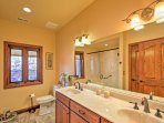 A double vanity provides ample counter space for couples' toiletries.