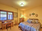 Recuperate after an adventurous day in the cozy queen bed of the second bedroom.