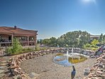 A fountain and lagoon add a lovely water feature to the backyard.