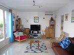 Air Conditioned Living Room with UK & France HD TV, DVD, Broadband, Phone, Audio & Library.  Balcony