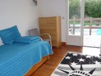 Air Conditioned Bedroom 3 with 2 X Single Bed.  Access to Decking, Terrace, Pool & Rear Garden