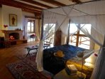 Kiota Safari House Bedroom. All bedrooms have gorgeous views and charming antiques and art.