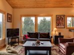 The living room has a gorgeous stone fireplace and large windows so you can sit and take in the views. There are two...
