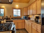 The kitchen is open to the living room and dining room. It is fully stocked with stainless steel appliances and...