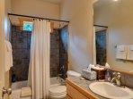 The additional 2 bedrooms are downstairs and share a bathroom in the hallway.