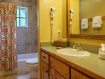 The upstairs two bedrooms share a full bath, also with a tub/shower combo.