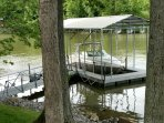 Covered Boat dock offers swimming and fishing and boat mooring.
