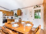 Large kitchen and dining table.