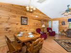 Spacious open floor plan with wood dining room table and chairs