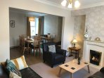 modern loungs flat screen tv DVD play station cosey live in flame fire. views to garden