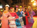 Women in a flamenco costume at the Fuengirola fair