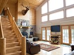Double French doors lead to large deck. Watch the wildlife or skiers on Deer Mountain.