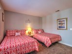 The second bedroom features 2 full beds, great for friends or siblings.