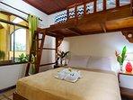 Condo 2, bedroom 1: Queen size bed with single top bunk.