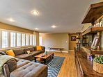 The living room features comfortable plush furnishings.