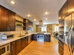 The fully equipped, gourmet chef's kitchen features pristine appliances, providing everything you need to whip up all...