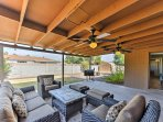 The covered patio is perfect for relaxing on lazy afternoons and enjoying barbecues with your travel companions.