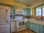A charming fully equipped kitchen makes cooking a delight.