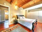 This bedroom features a queen bed and ample storage space.