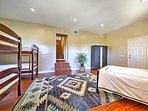 This spacious bedroom comes complete with a queen bed and 2 twin-over-twin bunk beds.