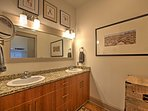 Couples will love the large counter space provided by the double vanity.