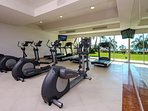 Gym with televisions and beach view