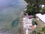 Aerial view showing ocean swimming hole and Villa including outdoor dining Fare