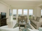 Enjoy the lovely sunsets each evening from this spacious living room with brand new furniture.