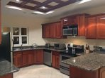 Beautifully appointed gourmet kitchen with granite & stainless steel Cuisinart appliances.