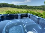 Relax in our 6 Person Spa with Beautiful Mtn Views