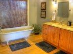 Remarkable Clawfoot Tub in Master Bathroom