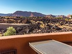Lanai off of upstairs master bedroom with red mountain view